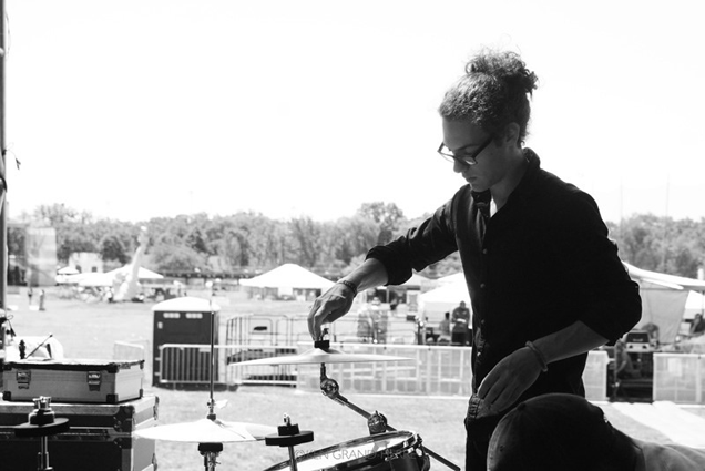 In the band's earlier, more DIY era, Bob Hall sets up his own kit at Governors Ball 2014