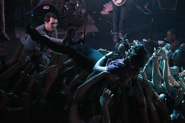 It may look like crowdsurfing; it's actually crowd cuddling