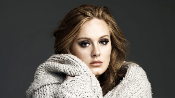Watch ADELE Perform new song 'When We Were Young'