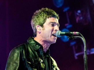 NOEL GALLAGHER gives away his awards and gold discs