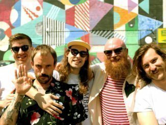 "IDLES release video for album favourite ""Never Fight A Man With A Perm"" - Watch Now"