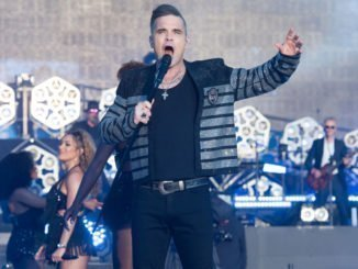 ROBBIE WILLIAMS wants to headline Glastonbury festival